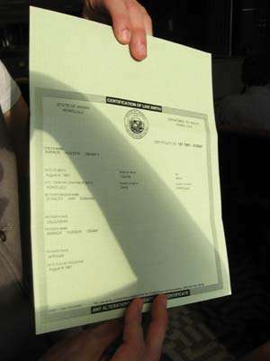 The Obama birth certificate, held by FactCheck.org writer Joe Miller in 2008.